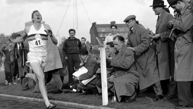 Roger Bannister hits the tape to become the first person to break the four-minute mile. Photograph