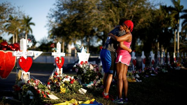 Adin Chistian, a student at Marjory Stoneman Douglas High School, embraces his mother Denyse, at a memorial to the victims of the shooting in Parkland, Florida. Photograph: Carlos Garcia Rawlins/Reuters