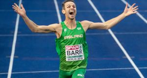 Ireland's Thomas Barr crosses the line to secure his bronze medal. Photograph: Morgan Treacy/Inpho