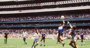 Argentina's  Diego Maradona gets his hand to the ball ahead of England goalkeeper to score the 'Hand of God' goal during the World Cup quarter-final at the Azteca Stadium in Mexico City during the 1986 World Cup. Photograph: Bongarts