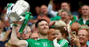 Séamus Hickey lifts the Liam MacCarthy Cup in Croke Park last August. The Limerick stalwart has since announced his retirement from the inter-county scene. Photograph: James Crombie/Inpho
