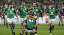 Johnny Sexton celebrates with Bundee Aki after scoring the match-winning  drop goal. Photograph:  Getty Images