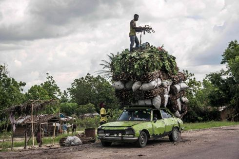 HEAVY LOAD: Vegetables, wood and charcoal are loaded onto the roof of a battered Peugeot in Matadi, Democratic Republic of the Congo. Photograph: Junior D Kannah/AFP/Getty Images
