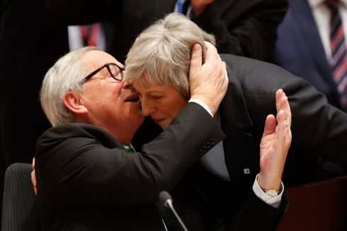 WARM WELCOME: European Commission president Jean-Claude Juncker greets British prime minister Theresa May during a roundtable meeting at an EU summit in Brussels. Photograph: Alastair Grant/AP