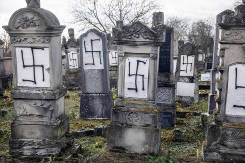 HATE CRIME: Jewish tombstones desecrated with swastikas in the Herrlisheim Jewish cemetery, north of Strasbourg, eastern France. Photograph: Jean-Francois Badias/AP