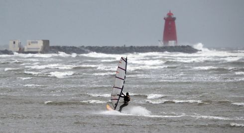 SURF'S UP: A windsurfer makes the most of the high winds near Dublin's Great South Wall. Photograph Niall Carson/PA Wire