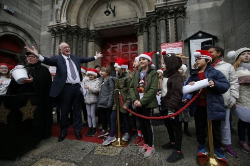 BLACK SANTA: Lord Mayor of Dublin Nial Ring during the performance by the choir of Kildare Place National School at the  Black Santa Sit Out fundraiser at St Ann's Church, Dawson Street, Dublin. Photograph: Nick Bradshaw for The Irish Times