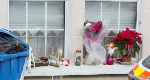 Flowers and candles on the window of Rosie Hanrahan's  home in Thomandgate. Photograph Liam Burke/Press 22