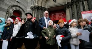 Black Santa Sit Out at St Ann's Church, Dawson Street, Dublin. Lord Mayor Nial Ring with  Nikolas Thornton, proudly showing off the Lord Mayor's chain of office during the the Choir of Kildare Place National Schooll's performance. Photograph: Nick Bradshaw