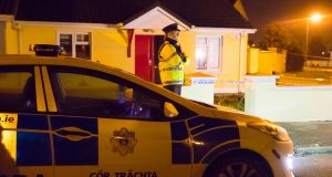 A Garda stands watch at the house where a man died after an assault at Coolfin Meadows, Portlaw, Co Waterford. Photograph: Patrick Browne