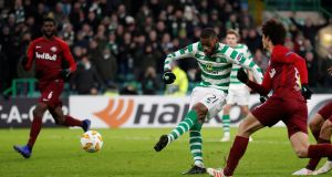 Celtic's Olivier Ntcham fires home the rebound after his penalty kick hit a post during the Europa League game against   Red Bull Salzburg at Celtic Park. Photograph: Russell Cheyne/Reuters