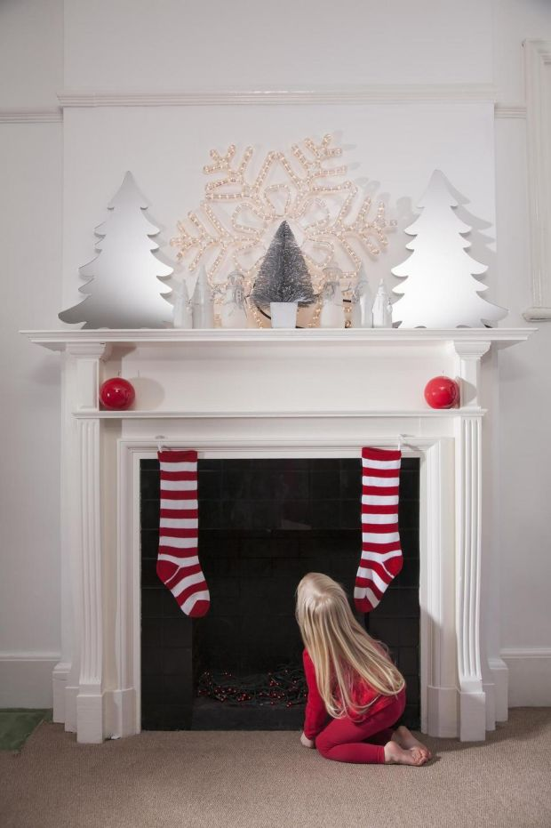 Be prepared for Santa's visit by calling in the chimney sweep, or cleaning it yourself. Photograph: Getty