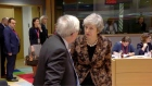 Camera captures tense exchange between May and Juncker