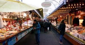People visit the Christmas Market, in Strasbourg, France, on Friday. Photograph: EPA