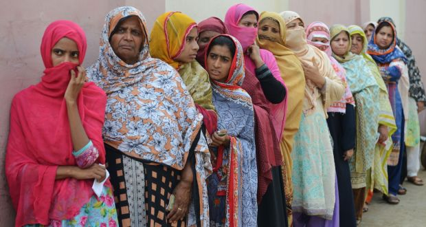 fe9c76581df Pakistani women queue to vote outside a polling station during the general  election in Lahore on