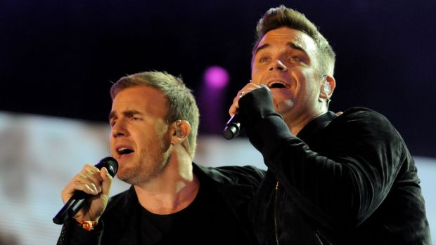 Robbie Williams and Gary Barlow of Take That performing at the Heroes Concert at Twickenham Stadium on September 12th, 2010. Photograph: Jim Dyson/Getty Images