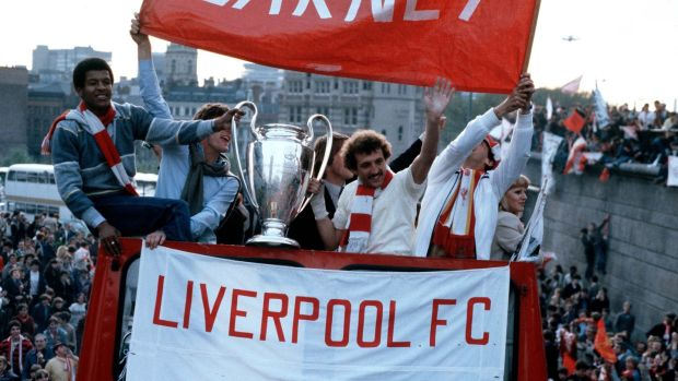 Howard Gayle holding the cup with Alan Kennedy as the victorious Liverpool team parade the European Cup on Merseyside after they had beaten Real Madrid 1-0 in Paris in 1981. Photograph: Bob Thomas/Popperfoto/Getty