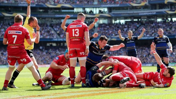 Leinster players celebrate as James Ryan scores his side's first try against Scarlets during the European Champions Cup clash at the Aviva Stadium. Photograph: Bryan Keane/Inpho