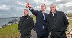Michael Creed, Minister for Agriculture, Food and the Marine, at Haulbowline Island  with  Cormac O'Suilleabháin  and Tim Lucey of Cork County Council. Photograph: Daragh Mc Sweeney/Provision