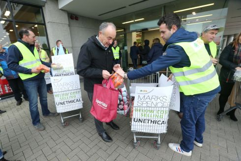 SHOP STEWARD: Irish fresh goods producers give away their produce at M&S Liffey Valley in Dublin in protest at below-cost selling of the produce by M&S. Photograph: Finbarr O'Rourke