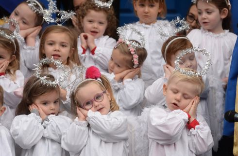 CRIB NOTES: Children from St Joseph's preschool, in Maryland, Dublin, sing Christmas carols at the launch of the live crib outside the Mansion House. Photograph: Dara Mac Dónaill/The Irish Times