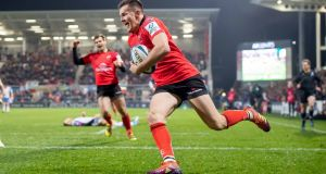 Jacob Stockdale crosses to score for Ulster against the Scarlets. Photograph: Morgan Treacy/Inpho