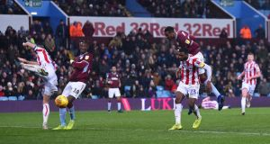 Jonathan Kodjia scores Aston Villa's second goal  during the Sky Bet Championship match against  Stoke City at Villa Park. Photograph: Nathan Stirk/Getty Images
