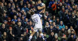 Leinster's Adam Byrne claims a high ball ahead of Darren Atkins of Bath during the  Champions Cup match at the Aviva Stadium. Photograph:  Dan Sheridan/Inpho