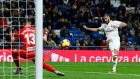Real Madrid's Karim Benzema scores their  goal in the La Liga game against Rayo Valecano at the Bernabeu. Photograph:  Juan Medina/Reuters