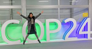 A participant jumps for a picture during the final session of the COP24 summit on climate change in Katowice, Poland. Photograph: Janek Skarzynski/AFP/Getty Images
