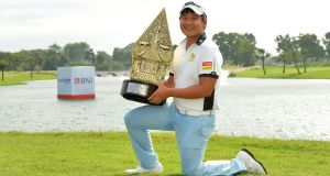 Poom Saksansin of Thailand posing with the winner's trophy after the final round of the Indonesian Masters at the Royale Jakarta Golf Club in Jakarta. Photograph: Arep Kulal/Asian Tour/AFP