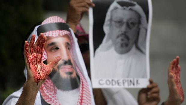 A demonstrator dressed as the Saudi Arabian crown prince, Mohammed bin Salman, with blood on his hands demanding justice for journalist Jamal Khashoggi. Photograph: Jim Watson / AFP/Getty Images