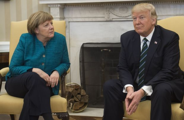 Bizarre snub: Angela Merkel with Donald Trump in the Oval Office in March 2017, when he refused to shake her hand. Photograph: Saul Loeb/AFP/Getty