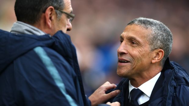 Brighton manager Chris Hughton and Chelsea manager Maurizio Sarri at the Community Stadium. Photograph: Dan Istitene/Getty Images