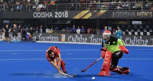 Florent Van Aubel of Belgium scores his team's third and winning penalty at Kalinga Stadium in India. Photograph: Charles McQuillan/Getty Images for FIH