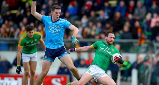 Dublin's Brian Fenton challenges Graham Reilly of Meath. Photograph: Oisin Keniry/Inpho