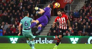 Charlie Austin scores the winner for Southampton at St Mary's Stadium. Photograph: Clive Rose/Getty Images