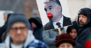 Placard depicting Hungarian prime minister Viktor Orban is pictured during a protest against a proposed new labour law in Budapest on Sunday. Photograph: Leonhard Foeger/Reuters