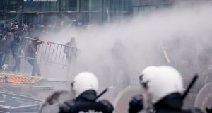 Protestors face off against the police during an anti-migrant demonstration outside of EU headquarters in Brussels. Photograph: AP