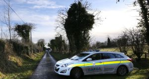 The scene at a house outside Strokestown, Co Roscommon, where a group of men arrived early on Sunday morning and ejected security personnel from the property. Photograph: Brian Farrell