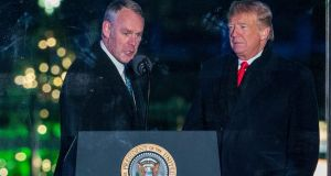 Former US secretary of the interior Ryan Zinke with President Donald Trump: Mr Zinke has been mired in allegations of political and ethical misconduct since he was appointed in 2017. Photograph: Erick S Lesser