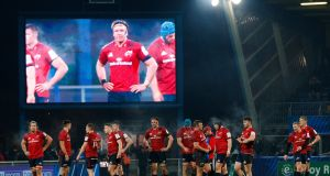 Munster players look on before Andrew Conway's try was disallowed during the  Heineken Champions Cup match against Castres at Stade Pierre Fabre. Photograph: James Crombie/Inpho