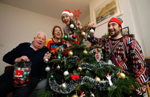 CHRISTMAS FOR ALL: Resident Mick McCarthy with volunteers Sinéad Davis, Fiona O'Regan and Brendan Daly as Alone tenants of Willie Bermingham Place in Dublin receive donated Christmas trees from Andy Kenny Fitness and FirTree.ie. Photograph: Nick Bradshaw for The Irish Times