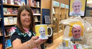 Evelyn Gaynor, store manager at Veritas, with some of the range of Pope Francis memorabilia and souvenirs on sale at on Dublin's Abbey Street. Photograph: Bryan O'Brien/The Irish Times
