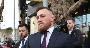 Conor McGregor leaves Dublin District Court after appearing in relation to motoring offences. Photograph:  Niall Carson/PA Wire