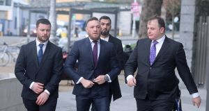 Conor McGregor (centre) arrives at Dublin District Court where he faced  motoring charges. Photograph: Niall Carson/PA Wire