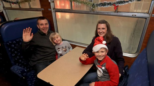 Joe and Mary Harpur with their children Sarah (4) and Thomas (8) onboard the Santa Express. Photograph: Donall Farmer