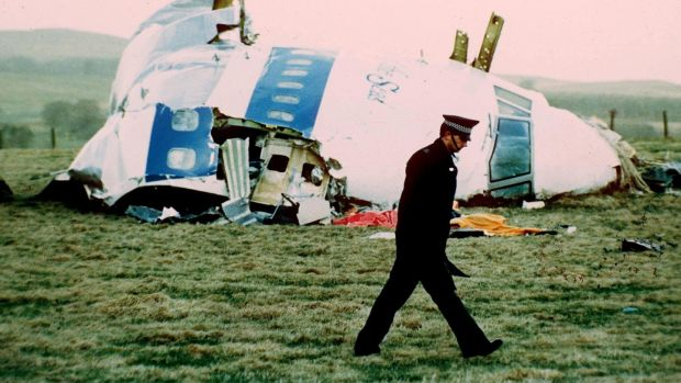 A police officer walks by the nose of PanAm Flight 103 in a field near the town of Lockerbie, Scotland. Photograph: Martin Cleaver/AP