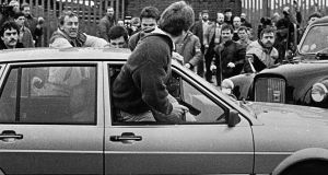 British Army corporal Derek Wood emerges from his car with a gun in his hand in Belfast in March 1988. Photograph: Pacemaker/Belfast