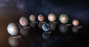 This artist's impression compares the seven planets orbiting the ultra-cool red dwarf star Trappist-1 to the Earth at the same scale.  They are shown to the same scale but not in the correct relative positions. Image: M Kornmesser/ESO